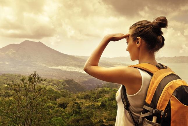 Woman traveler looking at Batur volcano. Indonesia